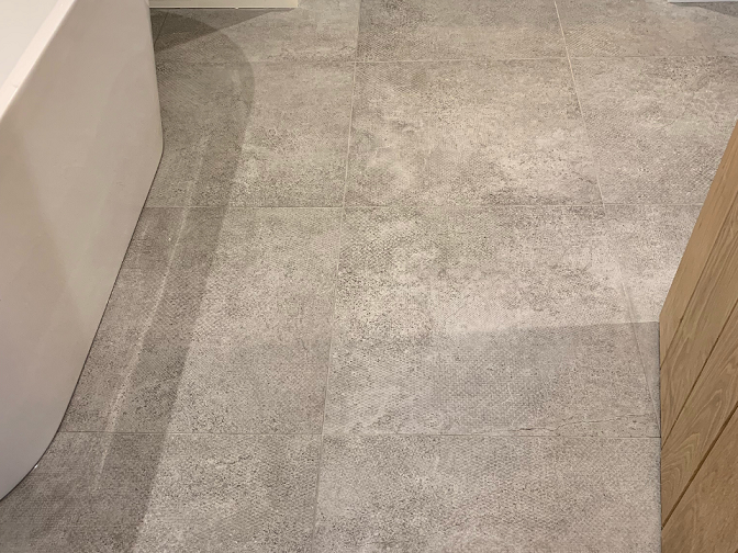 Cement effect tiles fitted with underfloor heating