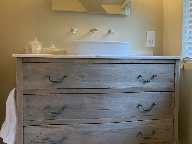 Chest of draws converted into bathroom unit with marble top