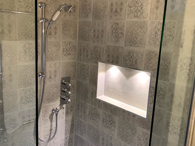 Fired earth tiles in ensuite shower area