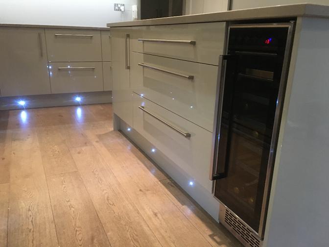 Kew Kitchen. Wine chiller. kick board Led lights. Howdens kitchen