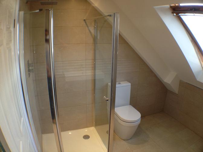 Kew bathroom complete refurbishment. concealed shower valve, rain fall head. new shower enclosure
