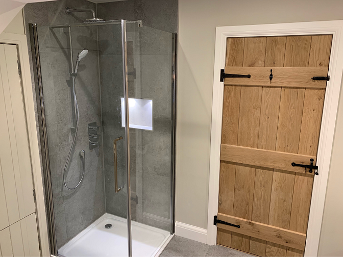 Shower area with inset lighted area for shower products etc